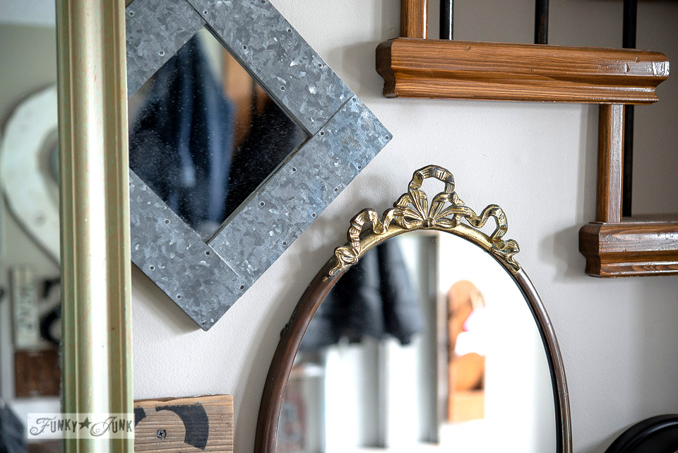 front entry mirror wall gallery / A fall home tour with hydrangeas and junk via FunkyJunkInteriors.net