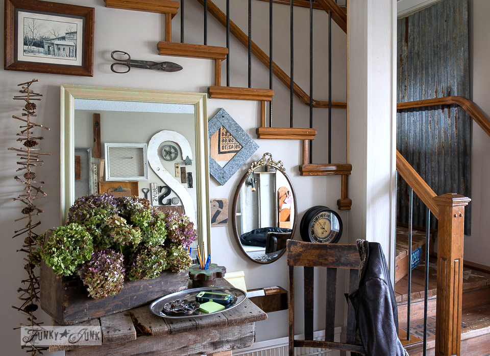 front entry wall gallery /A fall home tour with hydrangeas and junk via FunkyJunkInteriors.net