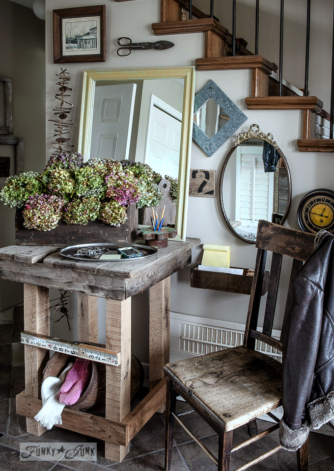 Hydrangeas on a front entry table on FunkyJunkInteriors.net
