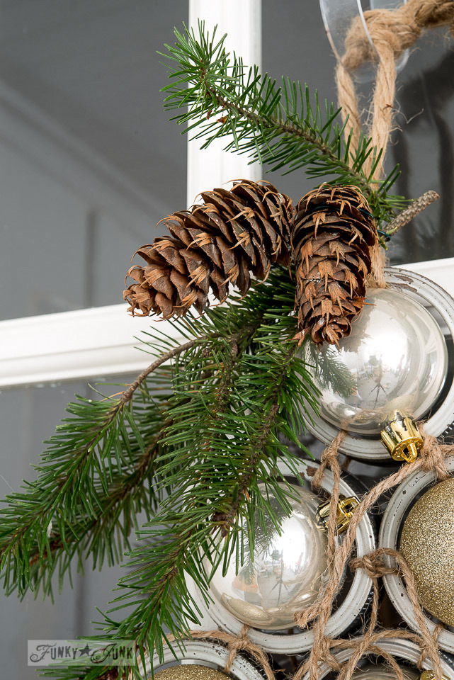 Learn how to make this industrial Mason lid Christmas ornament tree wreath, perfect for front door decorating for Christmas! Click to view full tutorial.