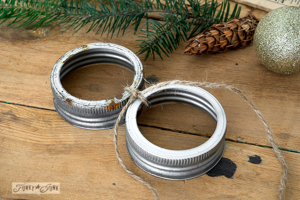 Tie lids together / Mason jar lid ornament Christmas tree on FunkyJunkInteriors.net