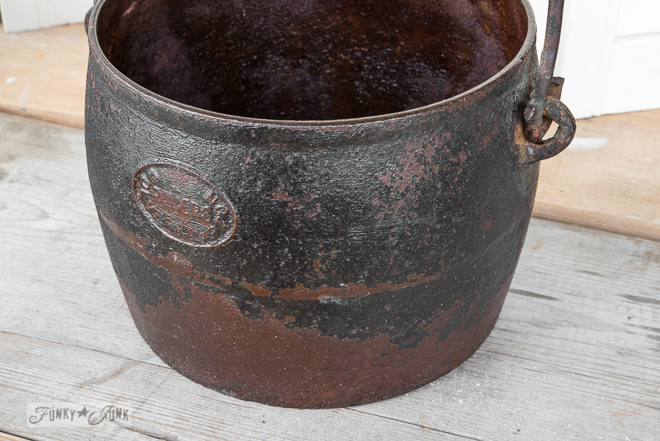 Cast iron black and rust pot / Conditioning rusty metal / how to prep junky pieces on FunkyJunkInteriors.net