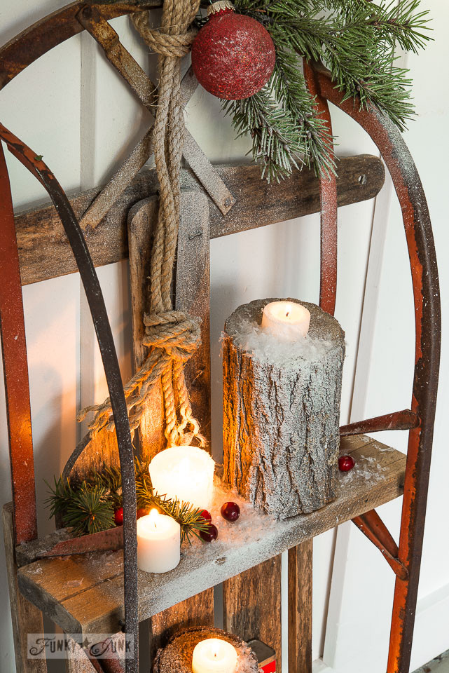 Candles on a log / Snow sleigh shelf on FunkyJunkInteriors.net
