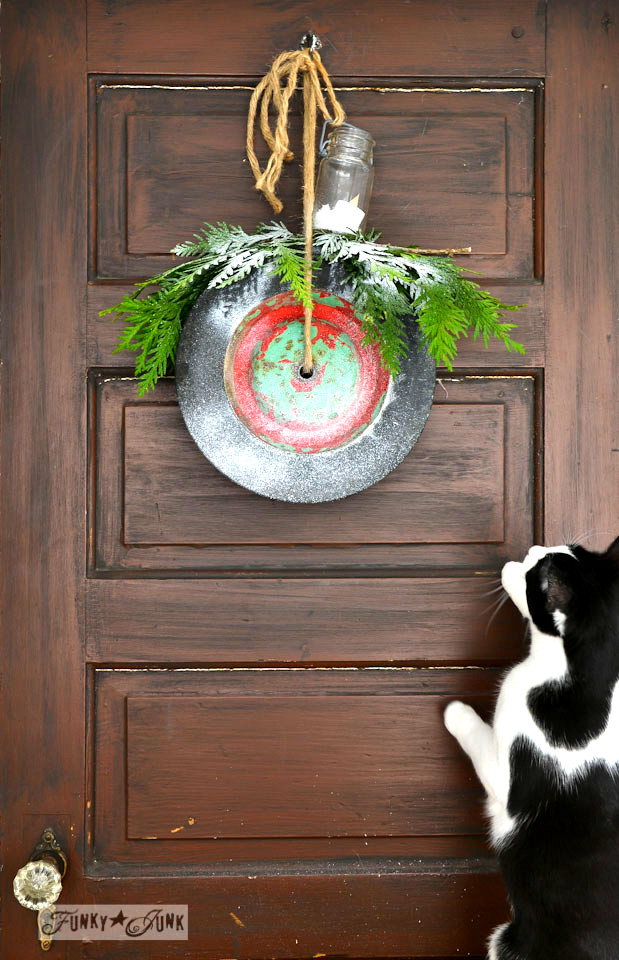 Old wheel Christmas wreath, on FunkyJunkInteriors.net