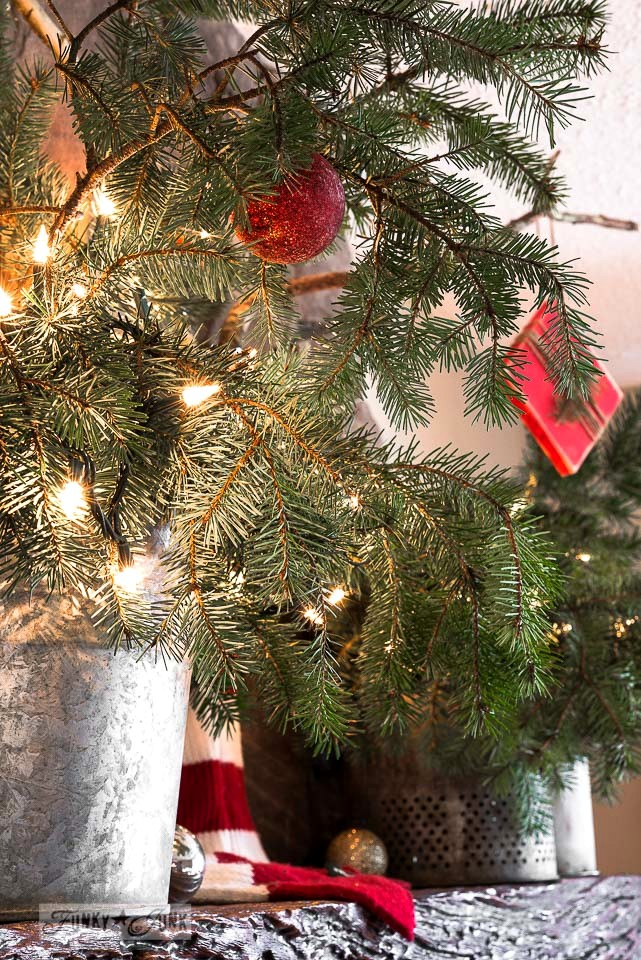 A reclaimed wood deer Christmas mantel on FunkyJunkInteriors.net