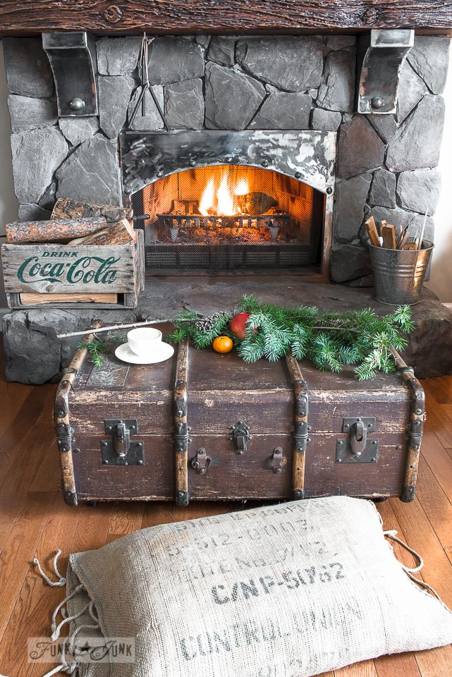 Old trunk coffee table / A reclaimed wood deer Christmas mantel on FunkyJunkInteriors.net