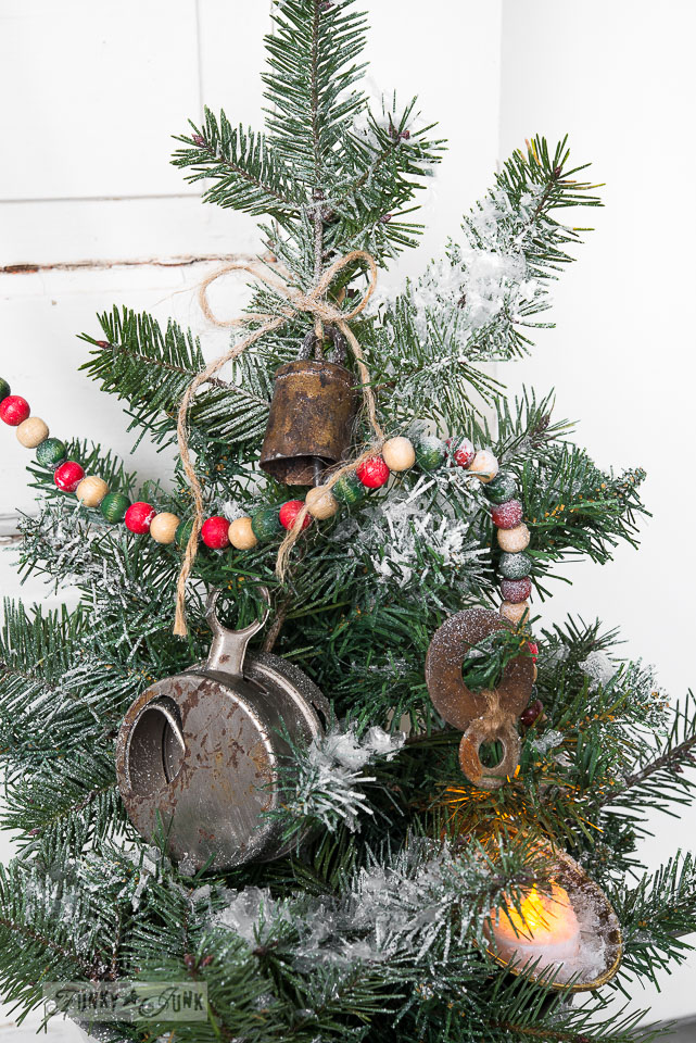 Junk ornaments / Faux to real mini Christmas tree in a strainer with wooden presents, on FunkyJunkInteriors.net