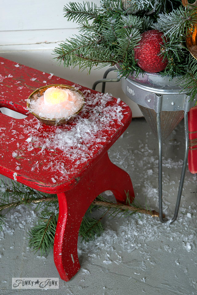 Plastic snow / Faux to real mini Christmas tree in a strainer with wooden presents, on FunkyJunkInteriors.net
