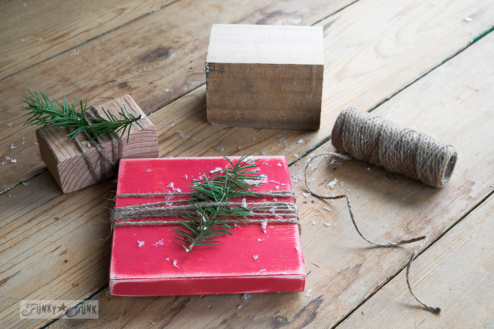 Wood block presents wrapped with twine / Faux to real mini Christmas tree in a strainer with wooden presents, on FunkyJunkInteriors.net