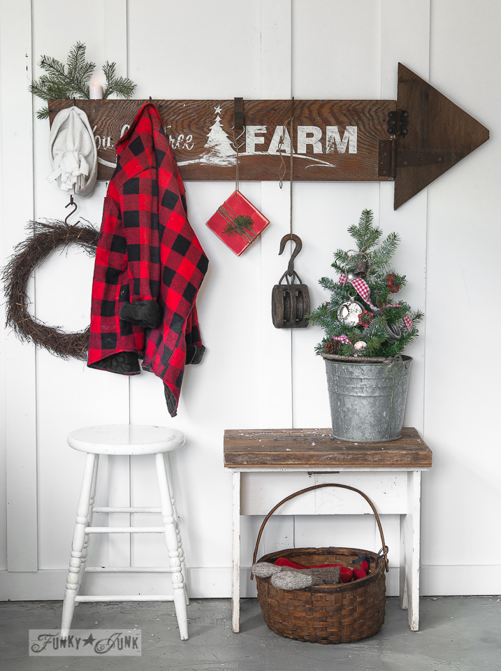 Learn how to make this rustic You Cut Tree Farm Christmas arrow sign with reclaimed wood, stencils and rusty junk! Perfect for Christmas decorating! Click to full tutorial and to find stencils by Funky Junk's Old Sign Stencils.