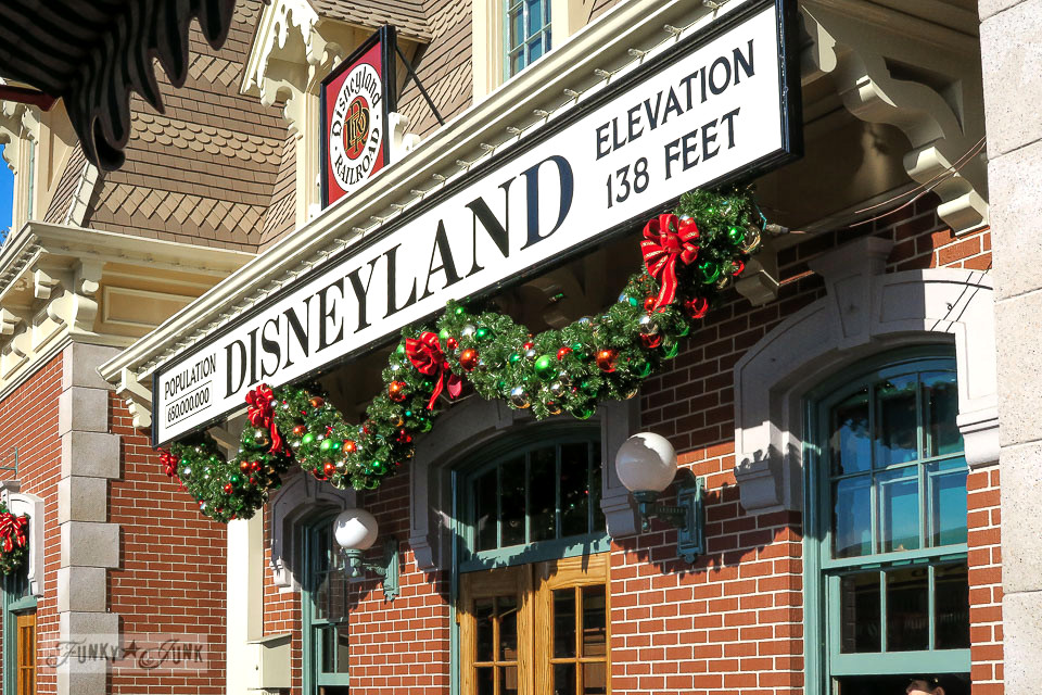 Train station Christmas garland at Disneyland   / FunkyJunkInteriors.net
