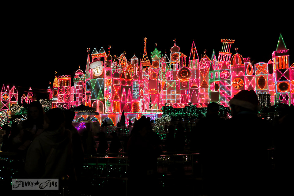 It's a Small World at night decorated for Christmas in Disneyland   / FunkyJunkInteriors.net