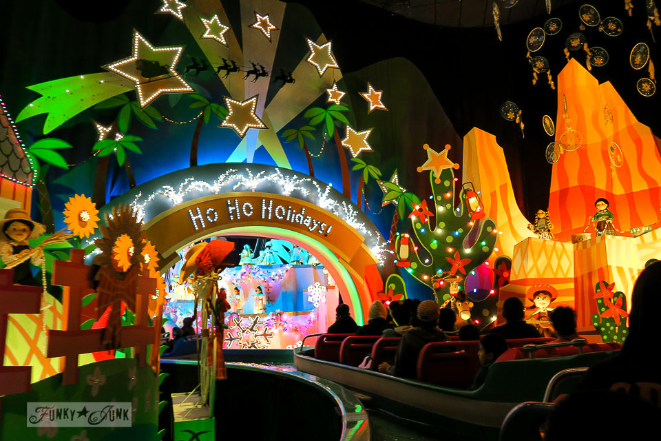 Inside the It's a Small World ride at night decorated for Christmas in Disneyland   / FunkyJunkInteriors.net