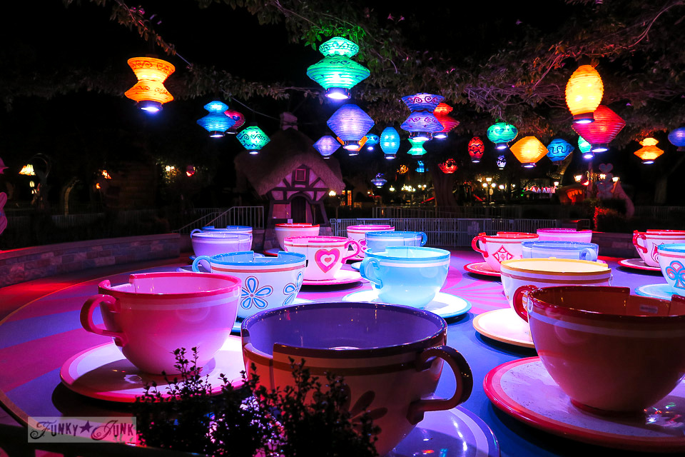 illuminated mad hatter teacup ride at night during christmas in disneyland funkyjunkinteriorsnet