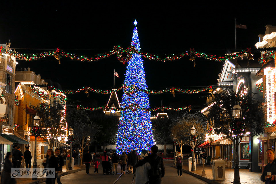 big christmas tree at night in disneyland funkyjunkinteriorsnet