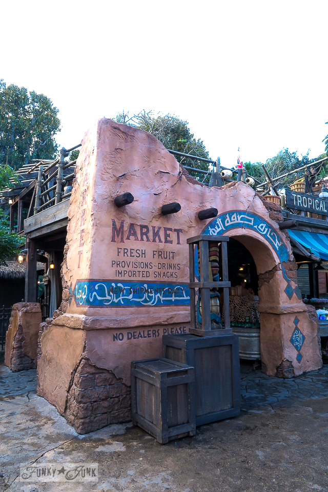 Mexican themed pink stucco  fruit stand near Indiana Jones at Disneyland during Christmas   / FunkyJunkInteriors.net