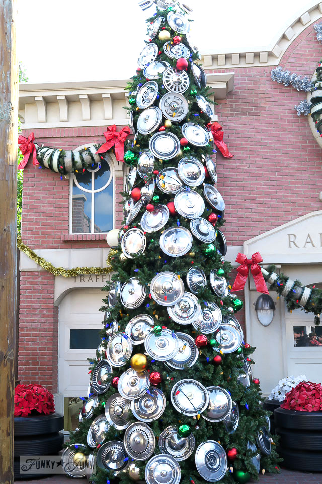 Hub cap covered Christmas tree / Merry Cars Christmas at Disneyland via FunkyJunkInteriors.net