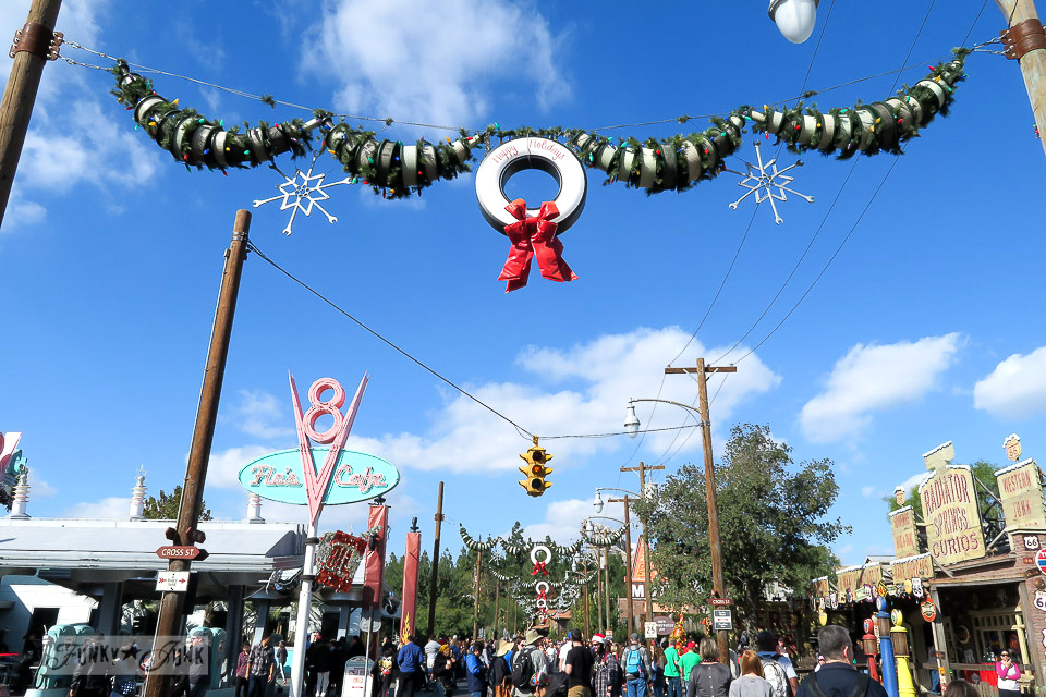 Car filter garland  with tire wreath / Merry Cars Christmas at Disneyland via FunkyJunkInteriors.net