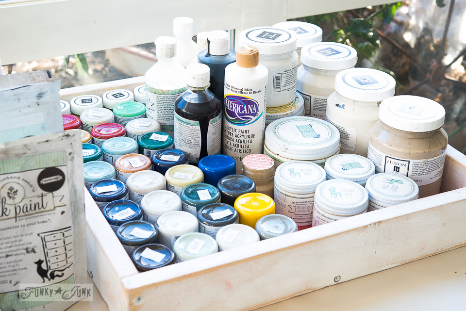 Paint organized in a reclaimed wood tray on FunkyJunkInteriors.net