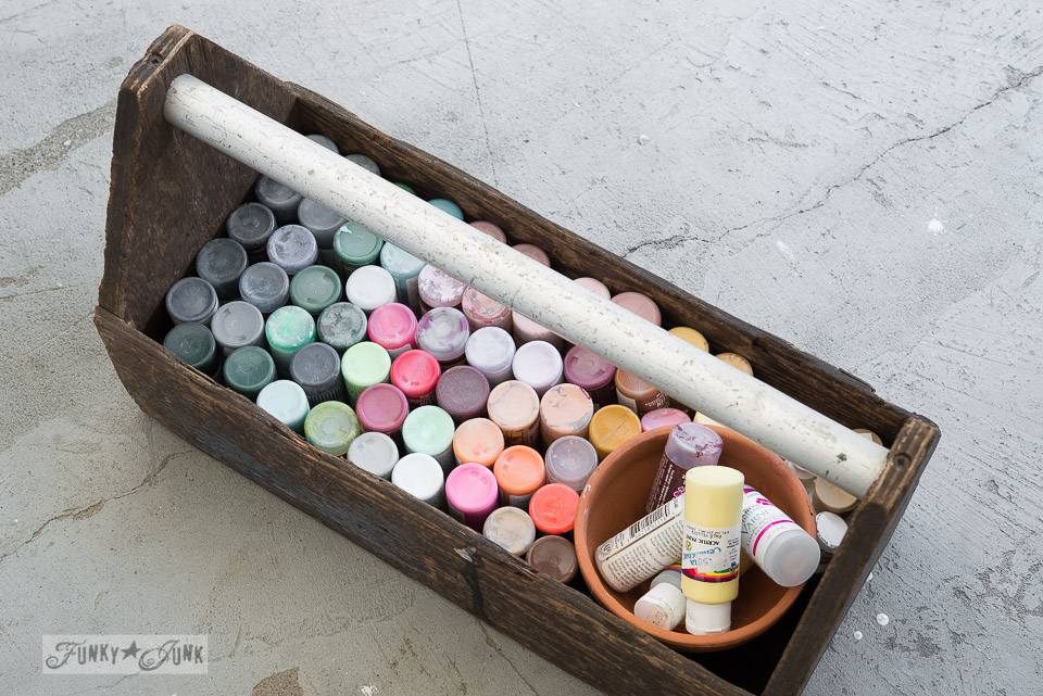 Craft paint organized in a toolbox on FunkyJunkInteriors.net