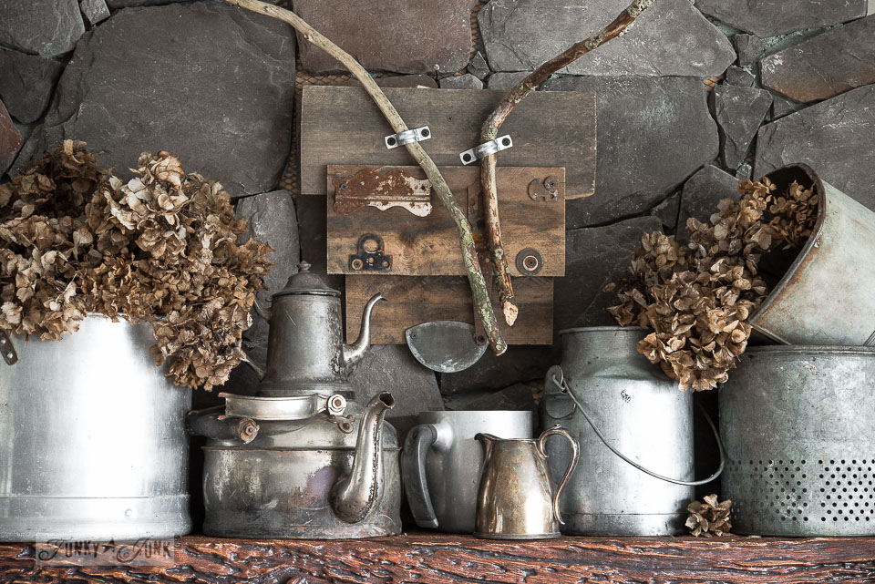 winter mantel with colourless, dried hydrangeas and galvanized buckets / funkyjunkinteriors.net