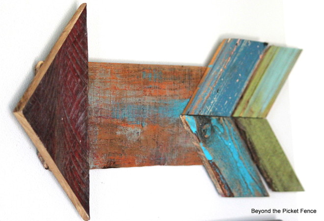 Colourful reclaimed arrow by Beyond the Picket Fence, featured on FunkyJunkInteriors.net