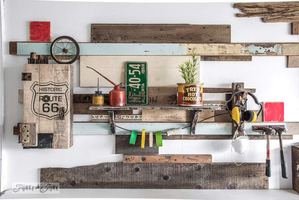 Reclaimed wood wall and Route 66 pallet wood cabinet in a workshop / funkyjunkinteriors.net