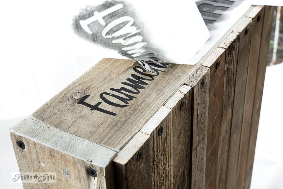 Spray adhesive tips with Funky Junk's Old Sign Stencils on an old crate