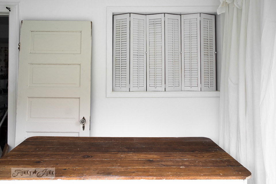 Photo studio photography backdrop with a door, table and shutters