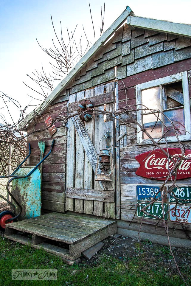Rustic garden shed with old signs / Growing rust in a spring yard / FunkyJunkInteriors.net