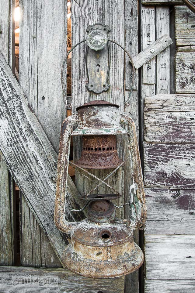 Rusty lantern on a rustic garden shed / Growing rust in a spring yard / FunkyJunkInteriors.net