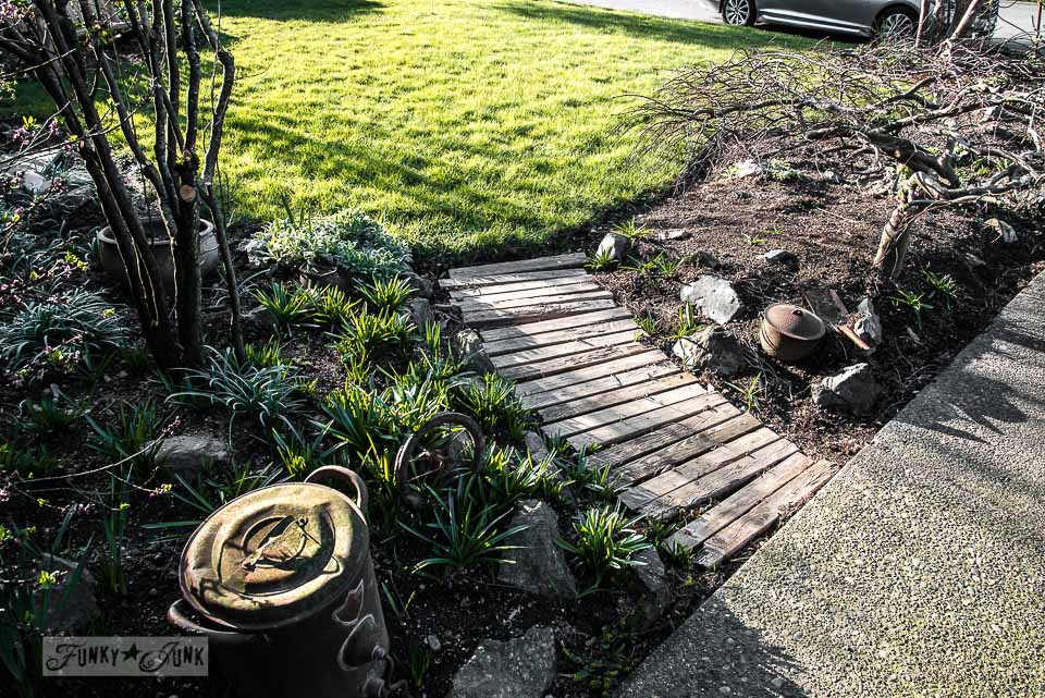 Pallet wood walkway / Growing rust in a spring yard / FunkyJunkInteriors.net
