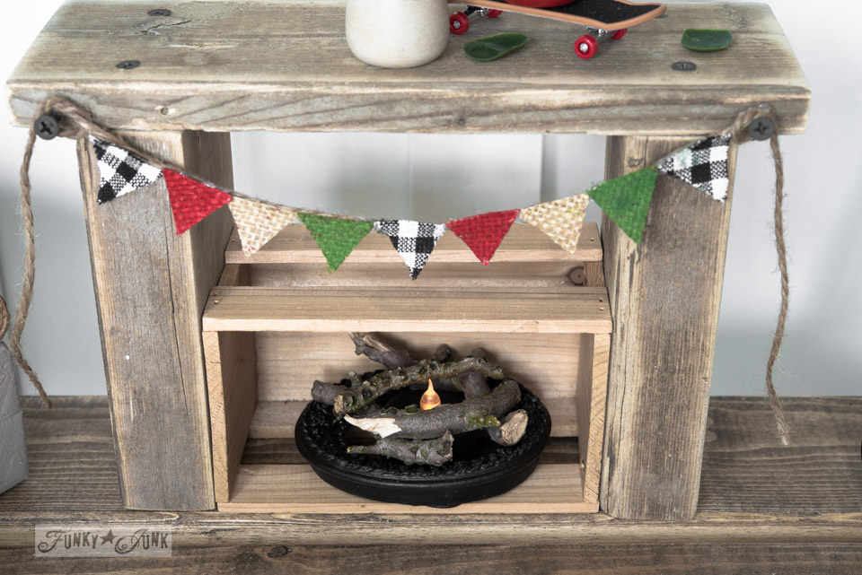 Reclaimed wood fireplace with burlap pennant and tea light flame / Upcycled dollhouse furniture! On FunkyJunkInteriors.net
