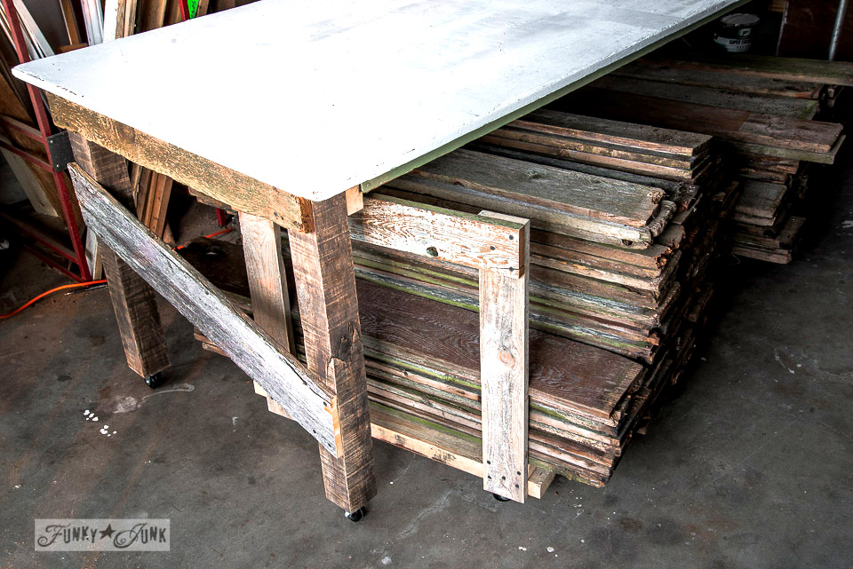 make a rolling shelf under a worktable to organize and store your reclaimed wood in your workshop / funkyjunkinteriors.net