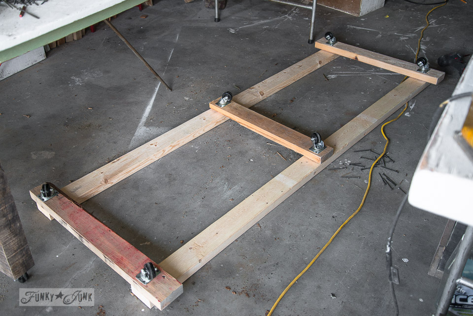 2x4 frame with casters for wood storage / Wood storage cart under a folding table to farm table workbench / FunkyJunkInteriors.net