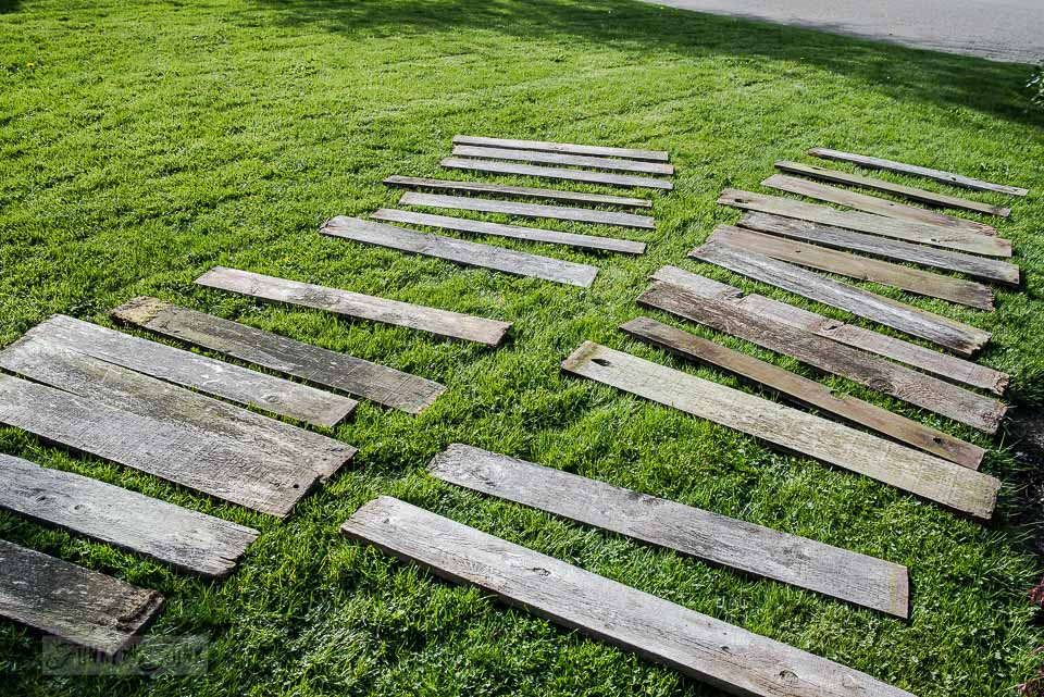 The easiest way to clean reclaimed wood / boards on lawn / FunkyJunkInteriors.net