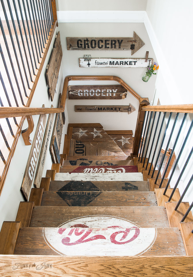 Rustic painted wooden crate stairs stenciled with vintage soda designs and reclaimed wood wall decor made with Funky Junk's Old Sign Stencils