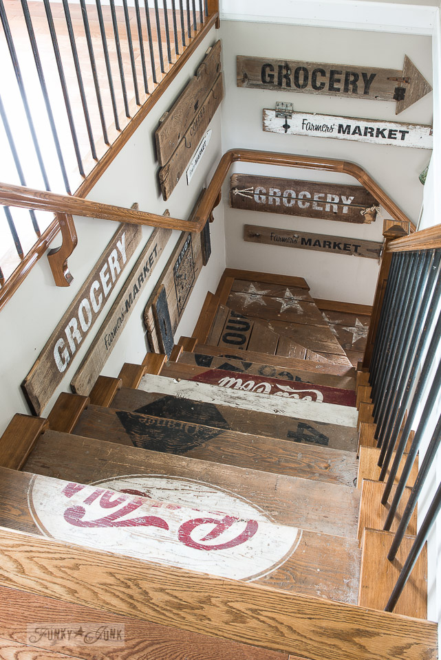 Old crate stairway with old signs wall gallery made with Funky Junk's Old Sign Stencils | funkyjunkinteriors.net