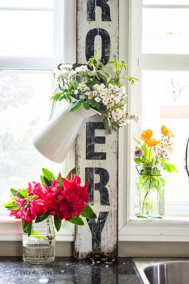 Summer flowers hanging on a sign / Funky Junk's 2015 Summer Home Junk Tour / FunkyJunkInteriors.net
