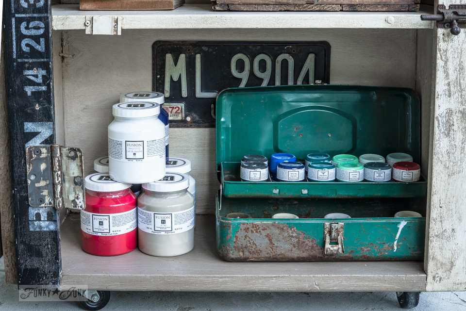 Fusion Mineral Paint storage inside an antique paint and stencil cart / FunkyJunkInteriors.net