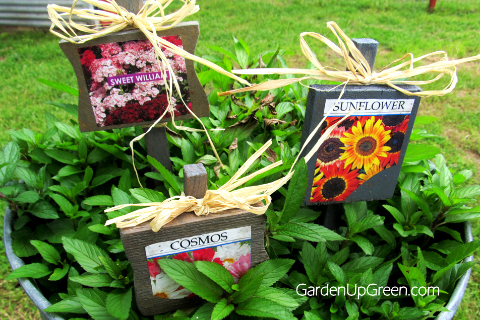 Garden markers from seed packs / Garden Up Green featured on Funky Junk Interiors