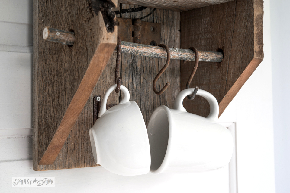 coffee cups hanging from rusty S hooks on a branch / Reclaimed wood rustic branch cabinet / FunkyJunkInteriors.net