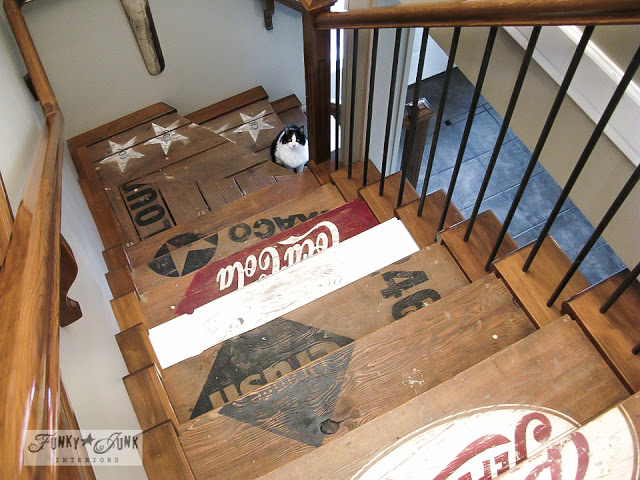 A painted crate stairway that is framed to accept carpet should this BC box home sell.