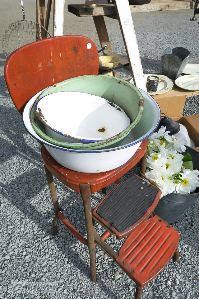 Red rusty step stool and enamel bowls at The Olde Farmhouse Vintage Market / funkyjunkinteriors.net