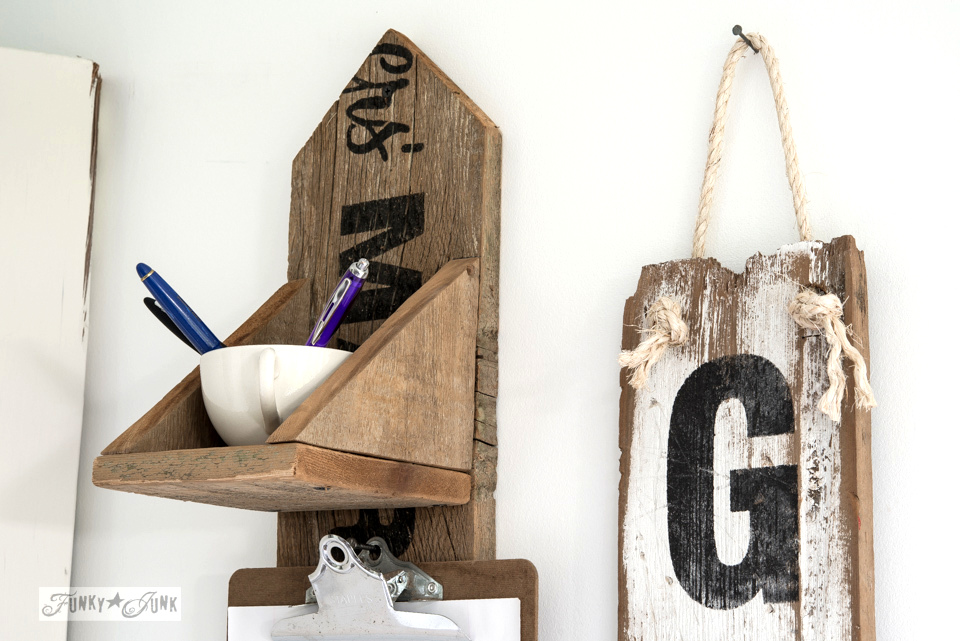 Learn how to create this rustic reclaimed wood message centre with vertical Grocery sign out of 2 fence planks and a couple of stencils! Click to full tutorial with lots of pretty pictures! #grocery #vintage #signs #stencils