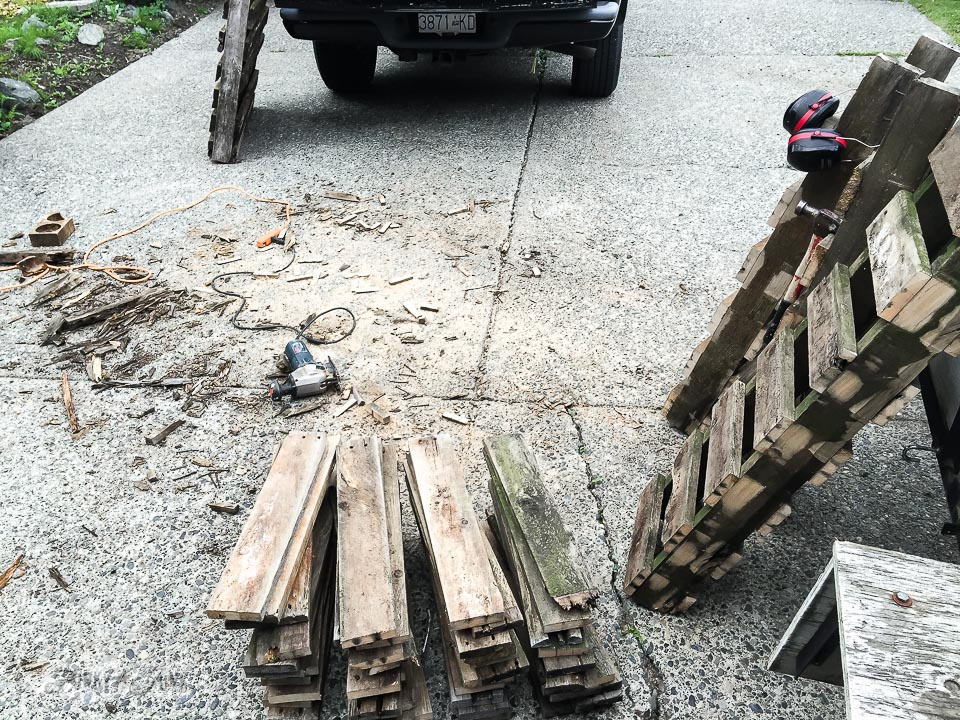 cutting pallets apart with a jig saw / why rotten pallet wood is a score / FunkyJunkInteriors.net