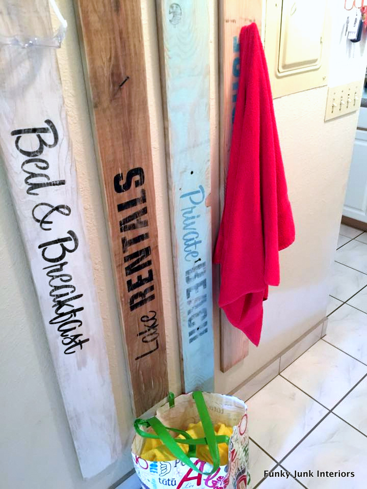 beach sign towel hangers for a Maui condo / funkyjunkinteriors.net