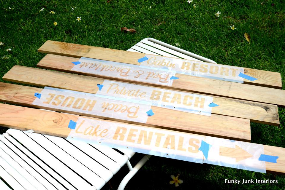 placing the stencils / Beach signs towel hanger / funkyjunkinteriors.net