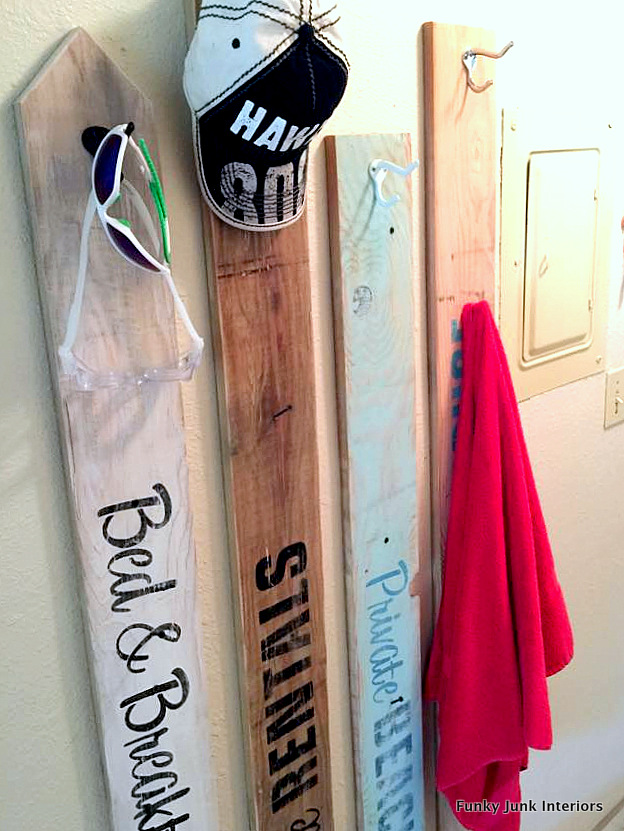 Learn how to make old beach sign towel hooks using wood planks and stencils! The perfect summer decorating idea with beach, lake and bed & breakfast themes! Click to read full tutorial and where to get the stencils.