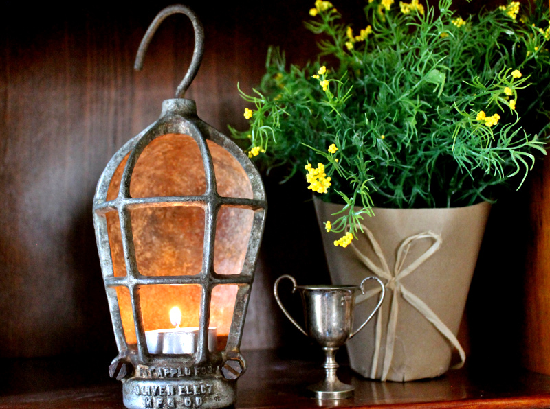 Vintage Shop Light Cage Turned Lantern by Adirondack Girl At Heart, featured on Funky Junk Interiors